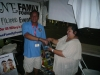 Vilma Gorre (community outreach coordinator of Shine Family Foundation) with Noel Cassimiro drawing winner of a man\'s gold bracelet donated by New York Diamond Exchange